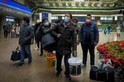 China says virus control top priority during upcoming holiday travel rush