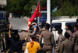 Thai protesters scuffle with police, fearing more royal insult charges