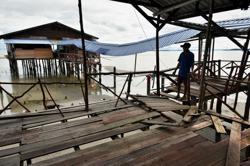 Popular Labuan restaurant wrecked during high tide phenomenon