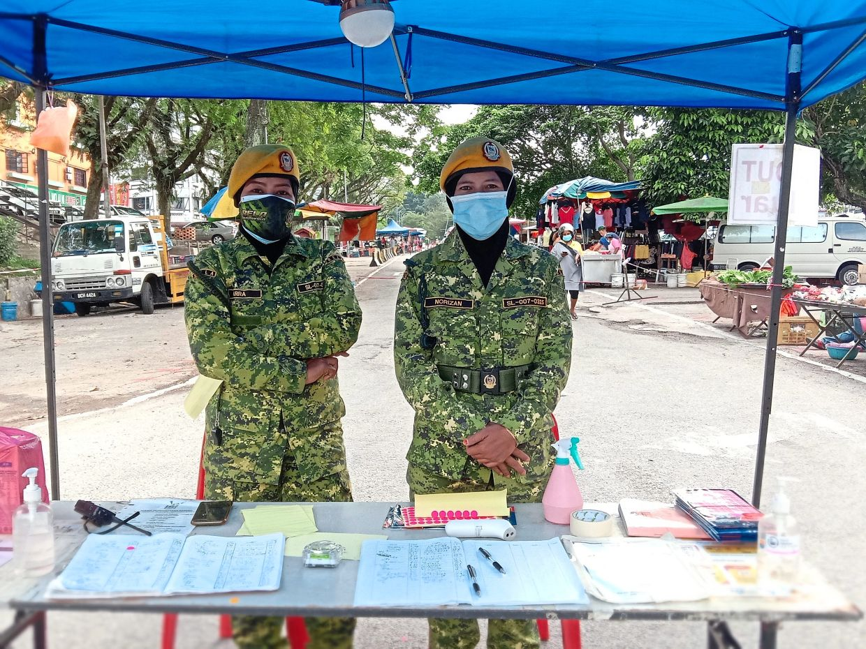 Rela officers at one of the two posts in Bandar Sungai Long morning market a day before the market was ordered to close.