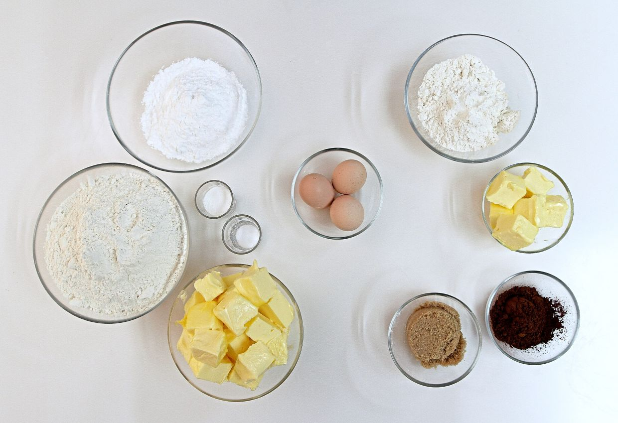 Ingredients for butter cookies are egg whites, unsalted butter, flour, icing sugar, baking powder and salt, while ingredients for chocolate cookies are just egg yolks, unsalted butter, flour, brown sugar and cocoa powder. — Photos: YAP CHEE HONG/The Star