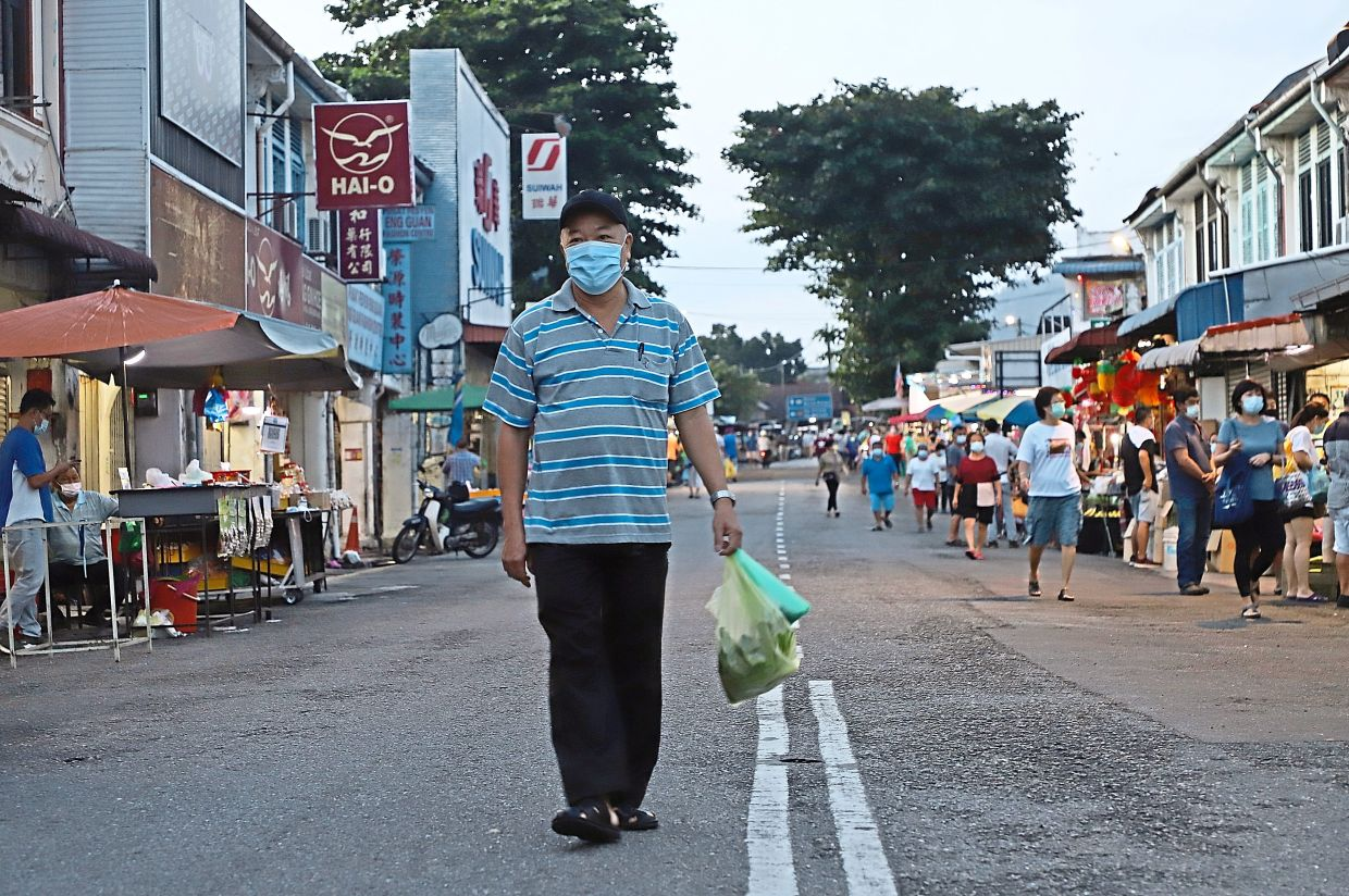 Businessman Teh Yan Chye, 67, walking on a road empty of the usual heavy traffic near the Ayer Itam market in Penang.