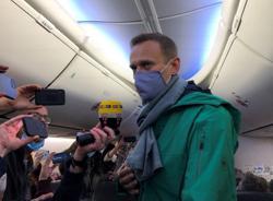 Kremlin foe Navalny lands in Moscow after plane diverted