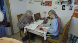 Old school: German great-grandpa pitches in with homeschooling