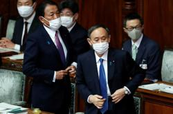 Japan PM Suga: Will exhaust all means to protect pandemic-hit medical system