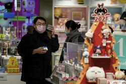 Chinese province ups restrictions amid outbreak; country gears up for holiday exodus
