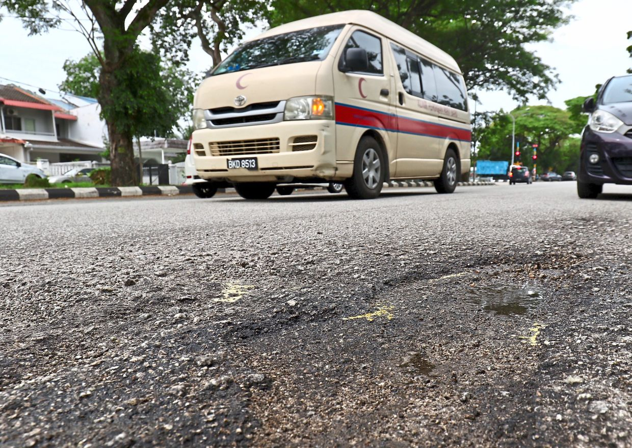 The bumpy ride as a result of potholes in Taman Klang Jaya can worsen the condition of patients in ambulances.