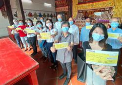 Temple hands out aid to 20 charities