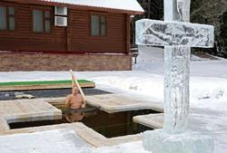 Russia's Putin marks Orthodox Epiphany with icy dip