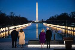 Biden leads Covid-19 memorial on eve of inauguration as US deaths pass 400k