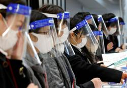 Japan says vaccination schedule for broader population undecided