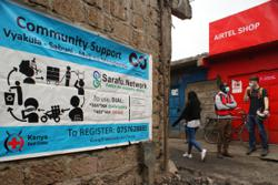 Kenya slum dwellers battle Covid-19 downturn with virtual currency