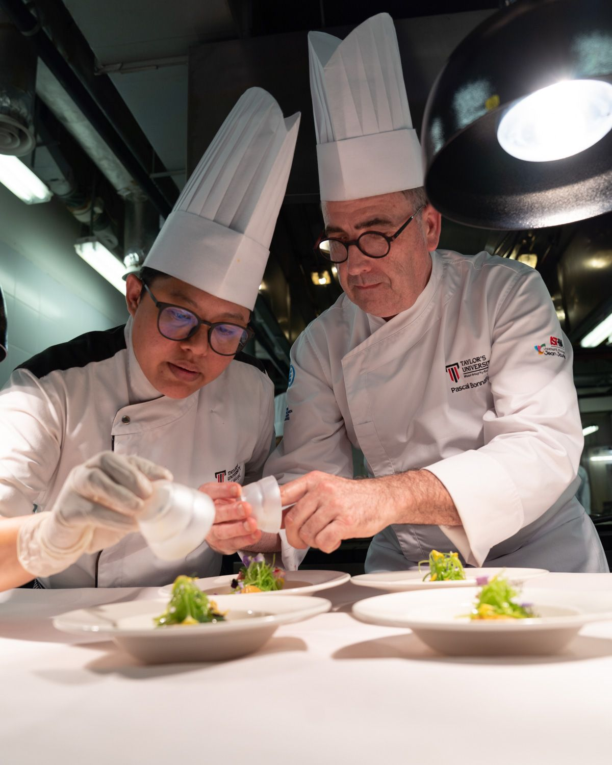 TCI lecturer Chef Massyittah Omar (left) and University of Toulouse lecturer Chef Pascal Bonnafous at work. The opportunity to collaborate with the right partners, such as the University of Toulouse, gives TCI students experiences that will boost their confidence, learning and overall experience.