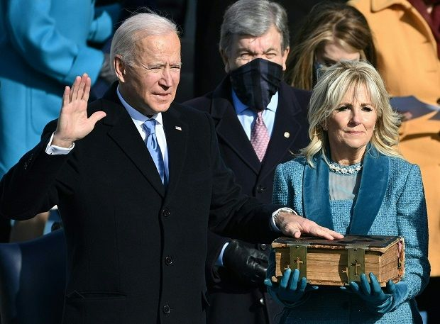 Joe Biden, flanked by incoming US First Lady Jill Biden takes the oath of office as the 46th US President by Supreme Court Chief Justice John Roberts during the swearing-in ceremony of the 46th US President on January 20, 2021, at the US Capitol in Washington, DC. -AFP
