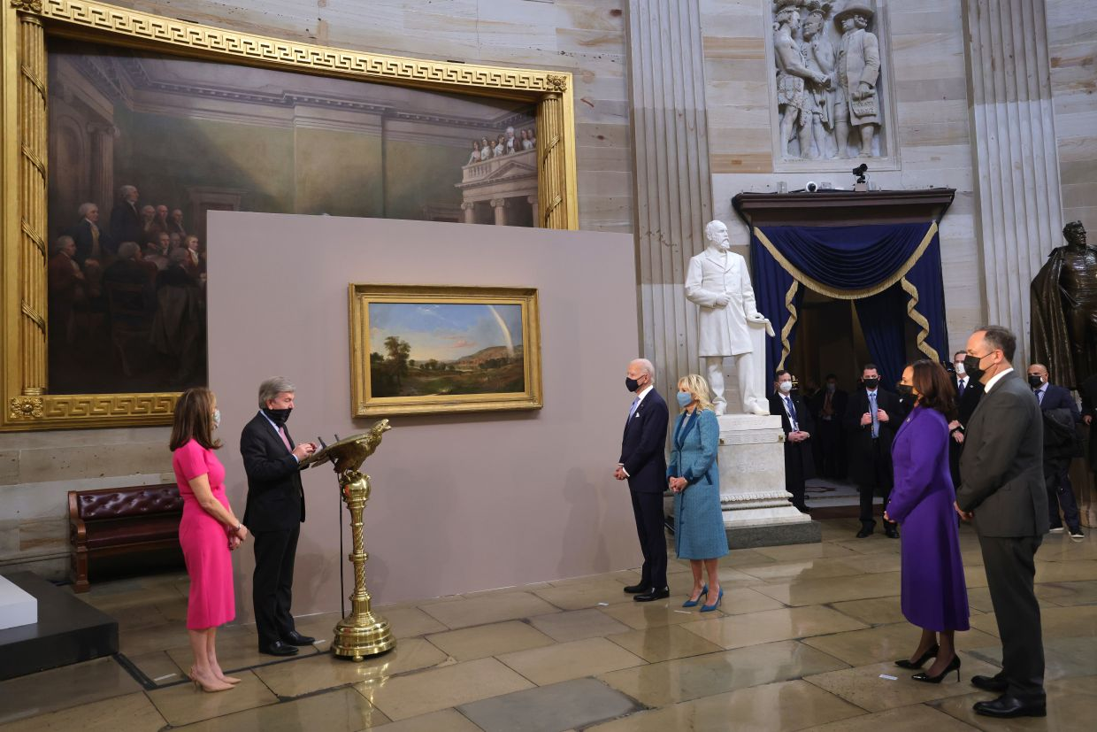 US President Joe Biden and First Lady Jill Biden are presented Duncanson's 'Landscape With Rainbow' painting from Roy Blunt, Republican from Missouri, left, in the Capitol Rotunda after the 59th presidential inauguration in Washington, D.C. on Jan 20. Photo: Bloomberg