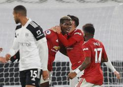 Pogba stunner sends Man Utd top with win at Fulham