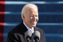 Biden puts US back into fight to slow global warming