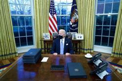 In hidden message on White House website, Biden calls for coders