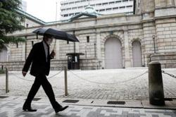 Bank of Japan revises up growth outlook for next two years