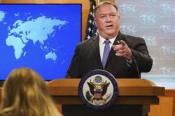 White House calls China sanctions on Trump aides 'unproductive'
