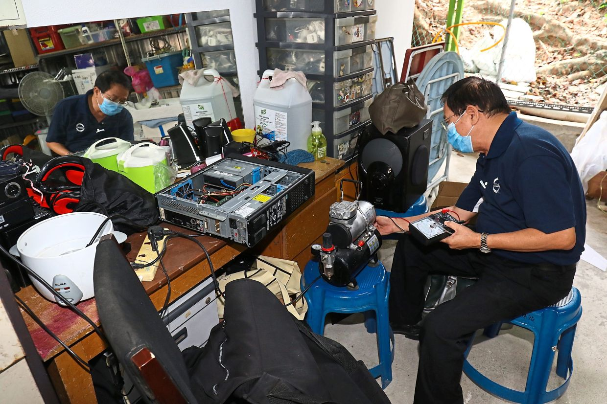 A Tzu Chi volunteer testing some of the equipment sent to its recycling centre in Bandar Sri Damansara.