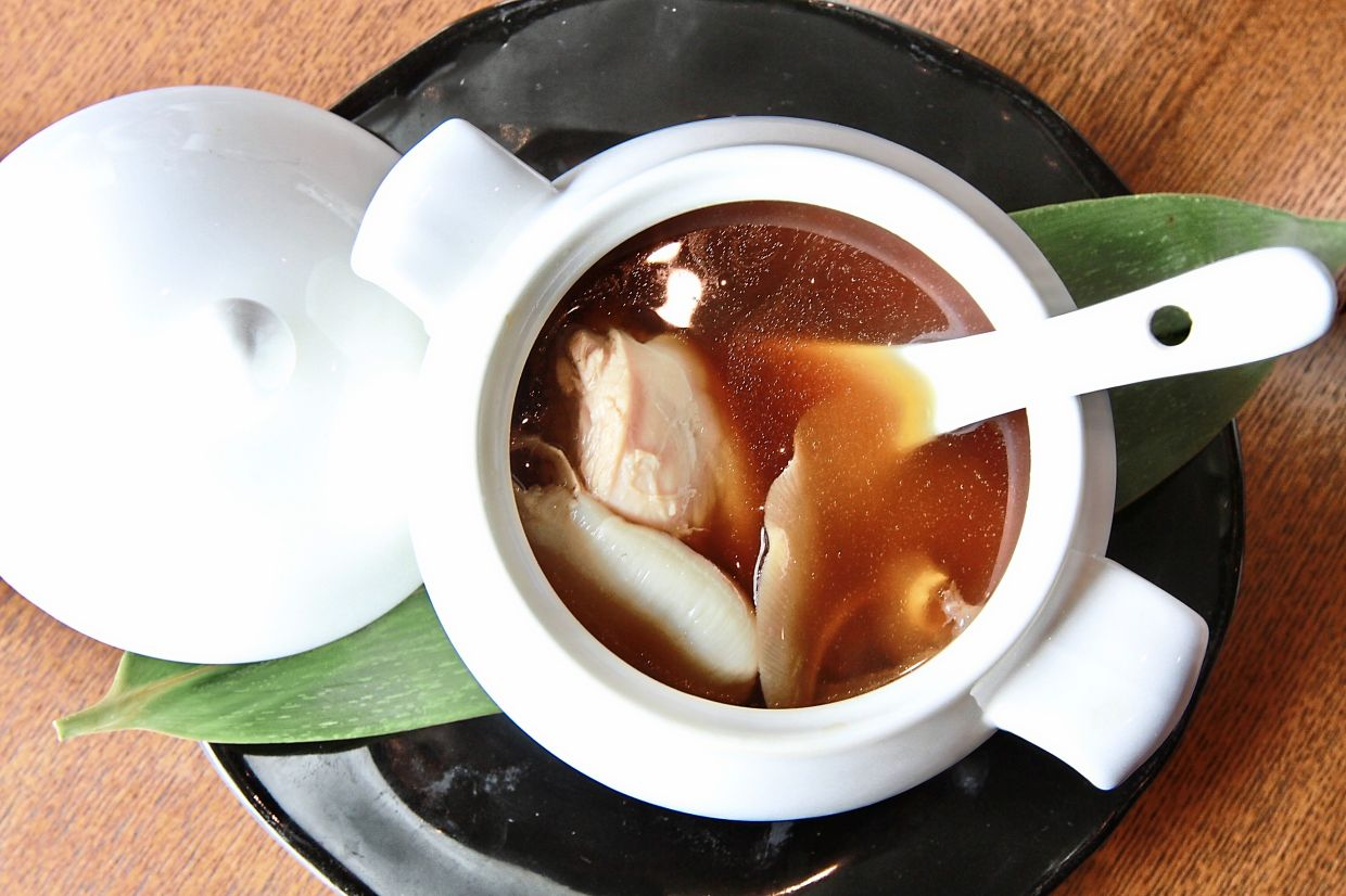 The Double-boiled Black Garlic Soup with fresh fish maw and chicken makes for  a truly  luxurious appetiser.
