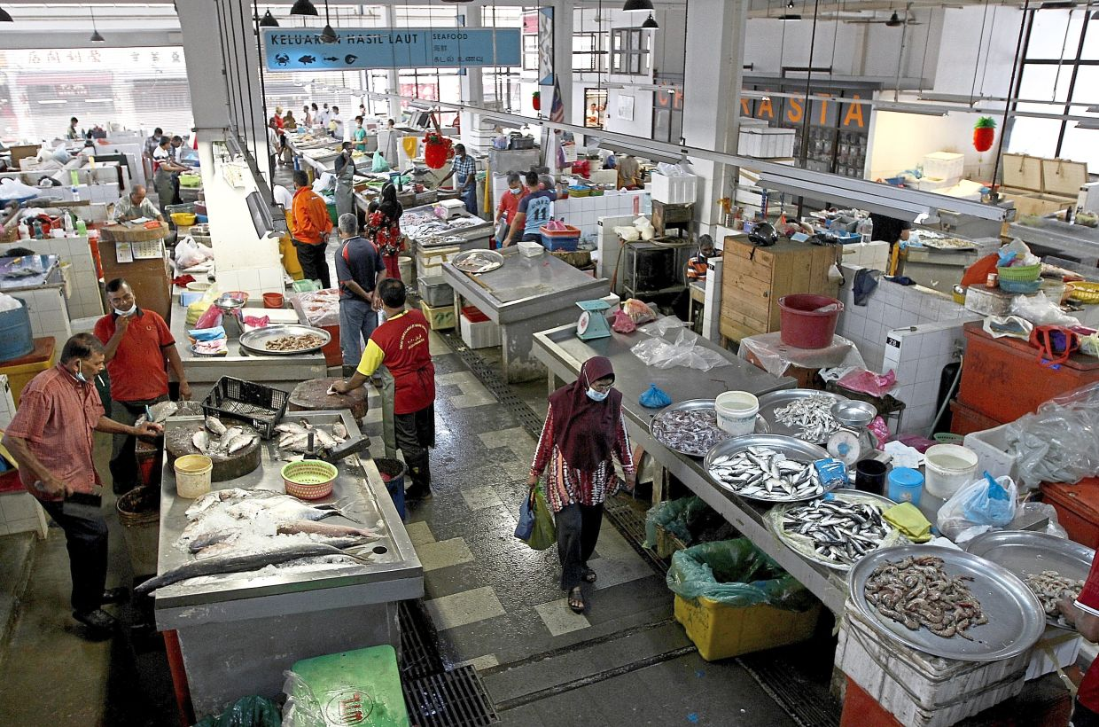 The wet market section is cleaner and better organised after the  upgrading project.