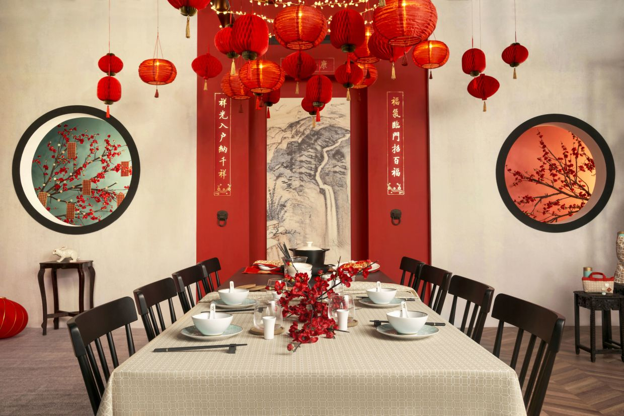 Traditional decorations and modern tableware add an air of festivity to the dining experience.