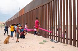 Pink seesaw playground at US-Mexico border wall wins top British design award