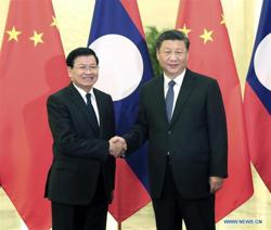China's Xi pledges support for Laos in its fight against pandemic
