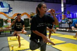 Phnom Penh yoga fans return to mat after lockdown - with a beer