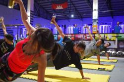 Yoga fans in Phnom Penh return to mat after lockdown - with a beer