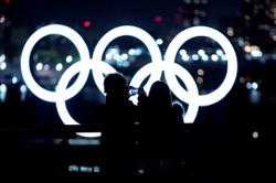 Japan PM says determined to realise Olympics, will cooperate with Tokyo and IOC