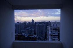 Shanghai imposes tougher rules on city's property market