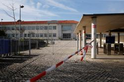 As COVID-19 cases rise, Portugal's hospitals face 'war-like' pressure