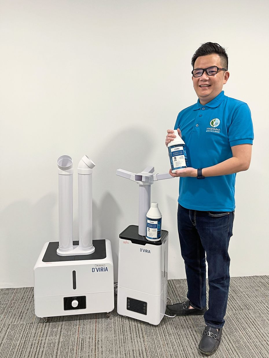 Lim with the new D'viria Nano CD disinfectant and atomiser machine.