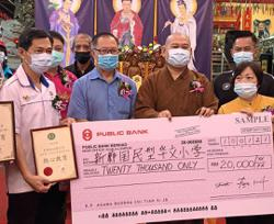 Pasir Gudang Buddhist temple presents donations worth RM46,000