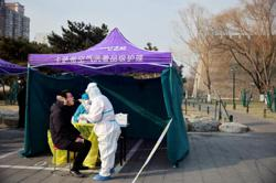 China: Govt reports 107 Covid-19 new cases; long queues as capital launches mass virus tests