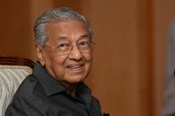 Dr M not hospitalised, says aide
