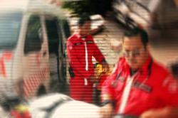 Medical officer injured after bike crashes into road divider in Sg Petani