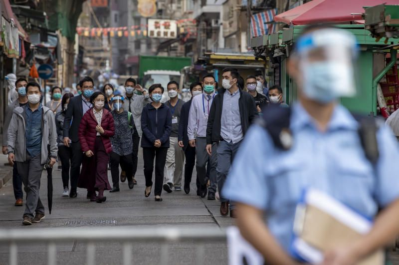 Carrie Lam, Hong Kong's chief executive (centre), walks in an area under lockdown in the Jordan area of Hong Kong, China, on Saturday. Hong Kong is locking down thousands of residents for the first time over the weekend in a bid to contain a worsening outbreak of the coronavirus. - Bloomberg