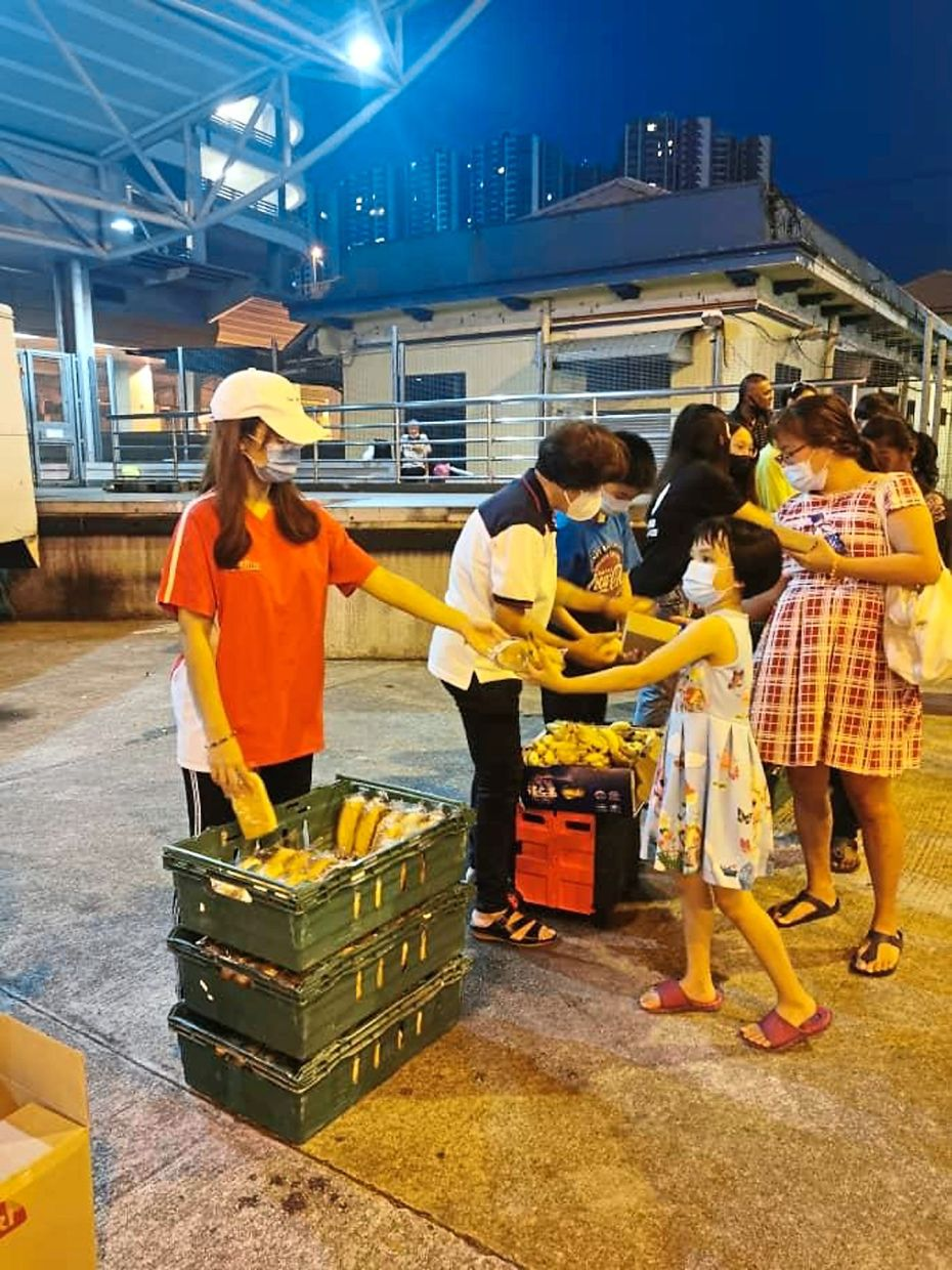 Volunteers distributing food to the homeless and those in need near the KTM Museum in downtown Johor Baru.