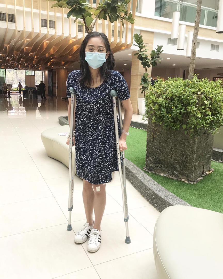 No change in Mission 2022: Rhythmic gymnast Izzah Amzan using the crutches as she leaves the hospital.