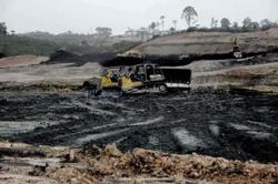 10 trapped as landslides hit coal mine in Indonesia's South Kalimantan