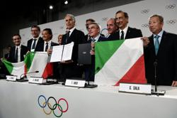 Olympics-Italy staves off threat of Olympic sanctions with decree