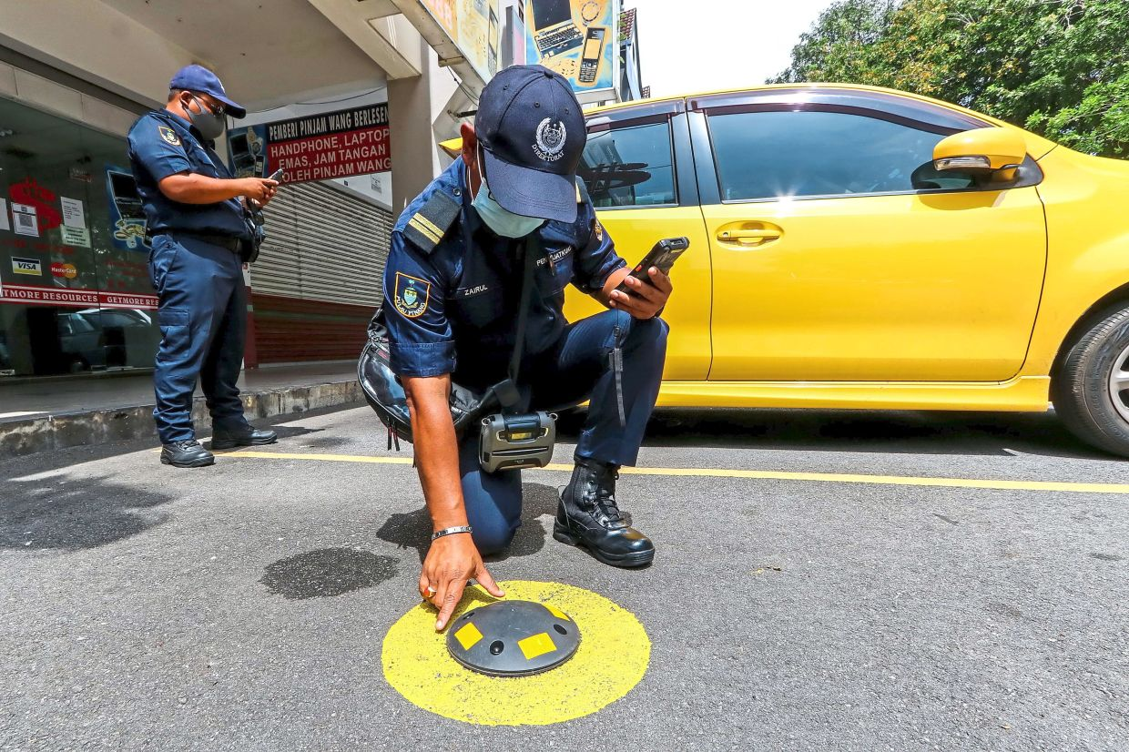 The Penang Smart Parking sensors have been installed on roads to assist motorists in navigating to a free spot using the app.