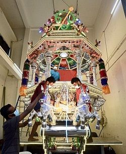 Final touch: Devotees preparing a chariot for Thaipusam. The chariot procession begins today from the Sri Maha Mariamman Temple in Jalan Tun HS Lee for its journey to the Sri Subramaniam Temple in Batu Caves. — S.S.Kanesan/The Star