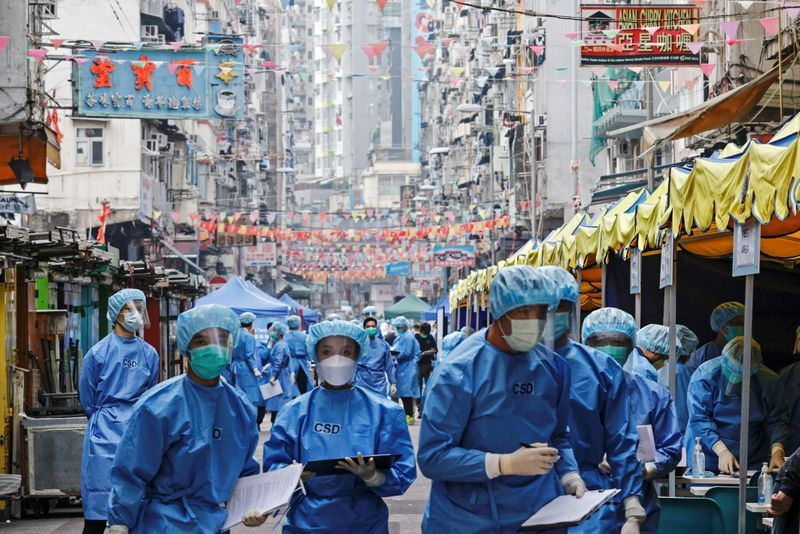 FILE PHOTO: Health workers are seen in protective gear inside a locked down portion of the Jordan residential area to contain a new outbreak of the coronavirus disease (COVID-19), in Hong Kong, China January 23, 2021. REUTERS/Tyrone Siu