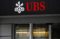UBS's CEO boosts buyback plans after wealth management surges