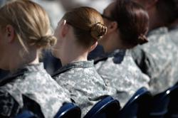 Ponytails and lipstick: US women soldiers get style